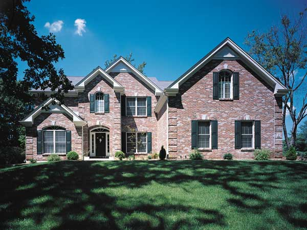 Luxury house design with multiple gables and brick.
