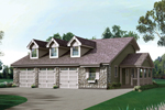 Three-Car Garage And Stonework Make A Nice Country Home