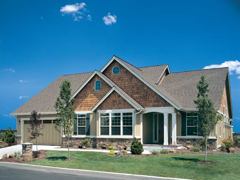 overlapping gables and its rustic design make this craftsman home - Craftsman Ranch Home Exterior