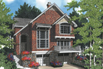 Cottage Styled Home With Deocrative Front And Brick Façade