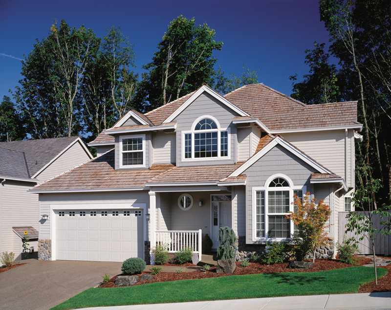 Home Has Attractive Dormers And Arched Windows