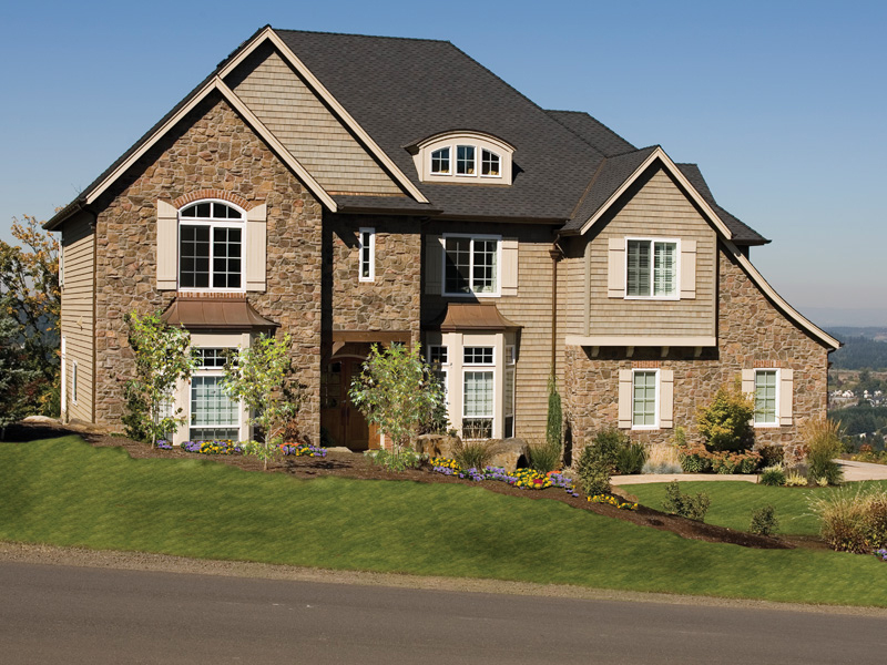 Luxury House Plan Front Photo 01 011S-0002