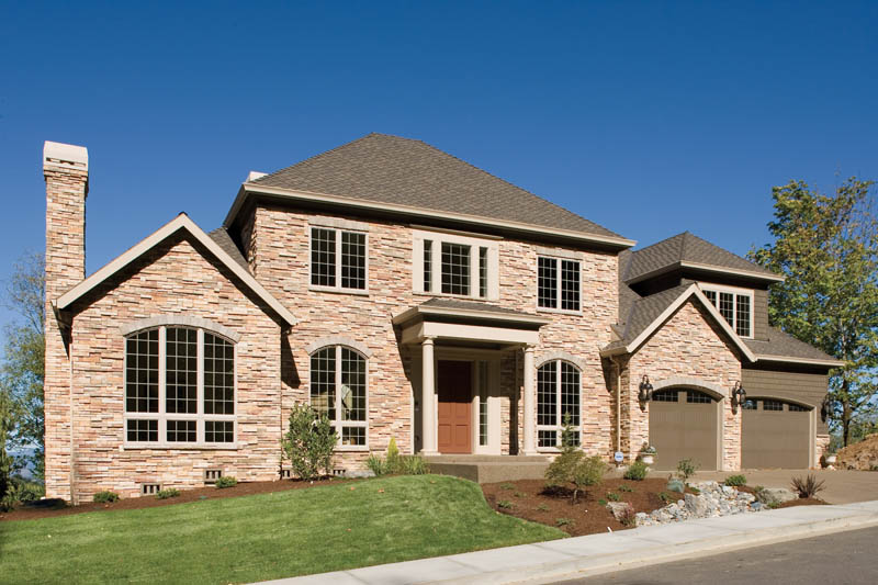 Luxury House Plan Front Photo 01 011S-0063