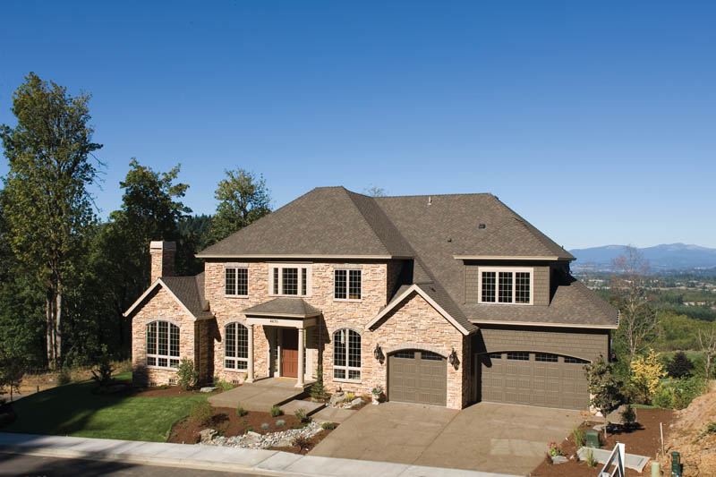 Luxury House Plan Front Photo 02 011S-0063