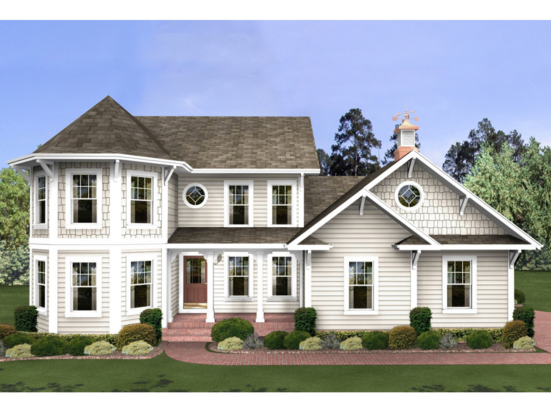 Two-Story With Double Bay Windows And Shingle Accents