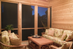 Screen porch is rustic yet spacious enough for outdoor enjoyment.
