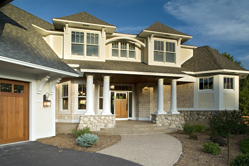 Luxury House Plan Front Photo 02 013S-0008