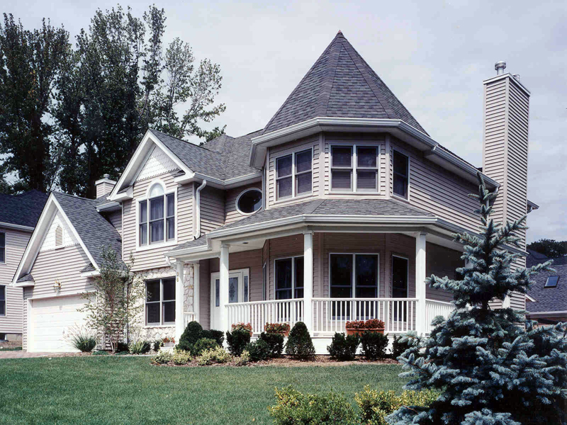 Victorian Style House With Striking Turret Wrapped By A Covered Porch