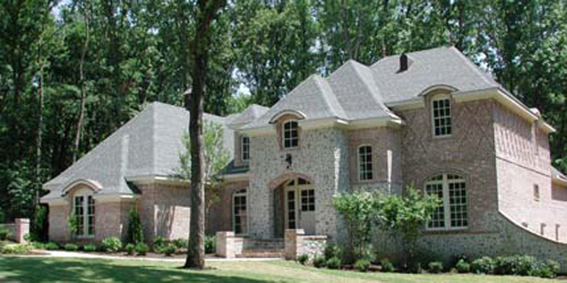 Two-Story Tudor Home With Brick Pattern details And Stonework