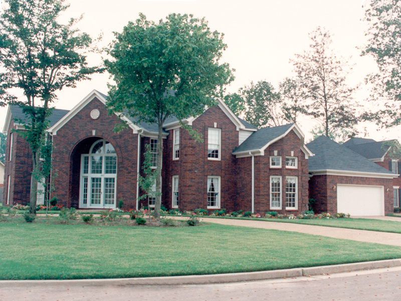 Two-Story Home With Grand Bay Window And Arched Entry