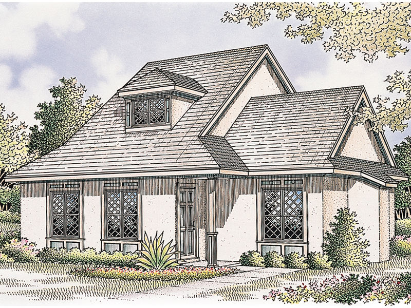 Two-Story Stucco Home With Detailed Window Design