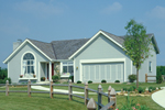 Traditional Ranch With Siding, Arch Window And Front Loading Garage