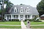 Southern Country Style Home With Three Dormers And Covered Front Porch