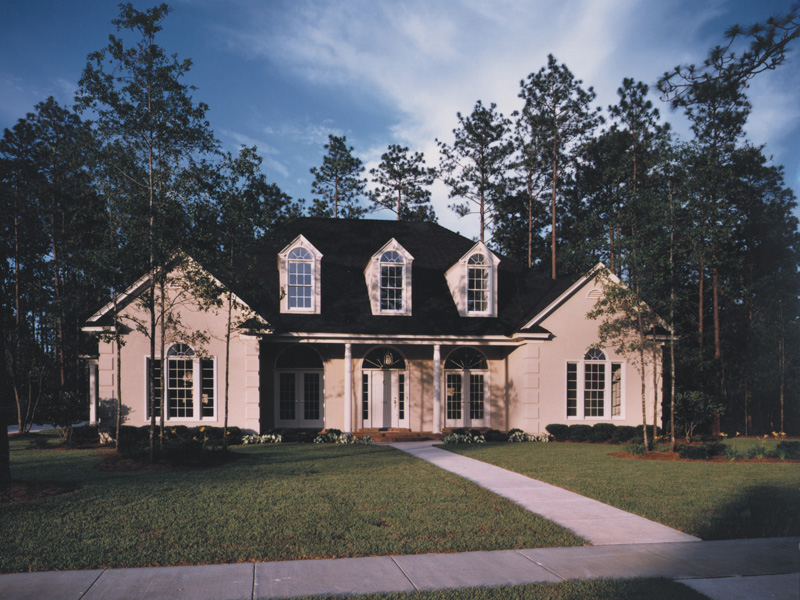 Symmetrical Southern Home With Arch Windows And Covered Porch