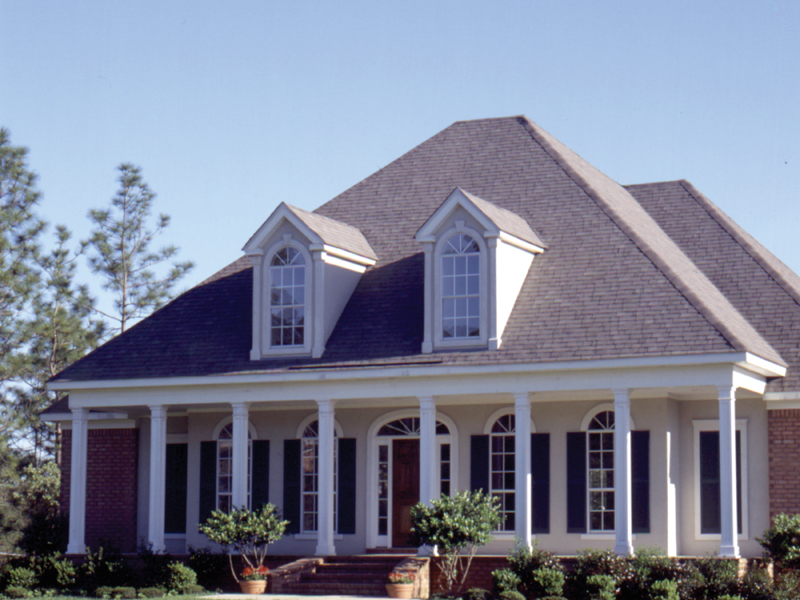 Columns Accent Facade And Frame Porch Of This Home