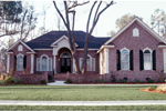 Striking Brick Ranch Home With Arched Entry And Windows