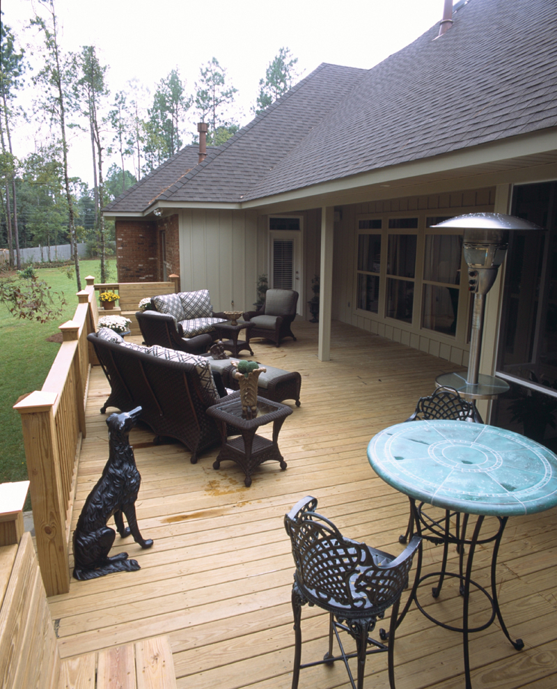 Expansive outdoor deck across the back of the home takes comfortable living directly to the outdoors
