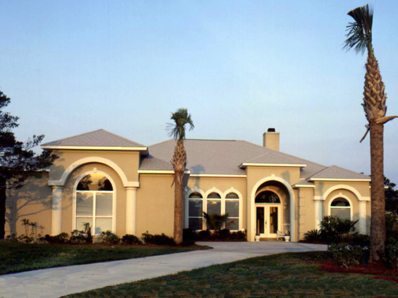 Sleek Stucco Home Has Rounded Windows And Front Entry