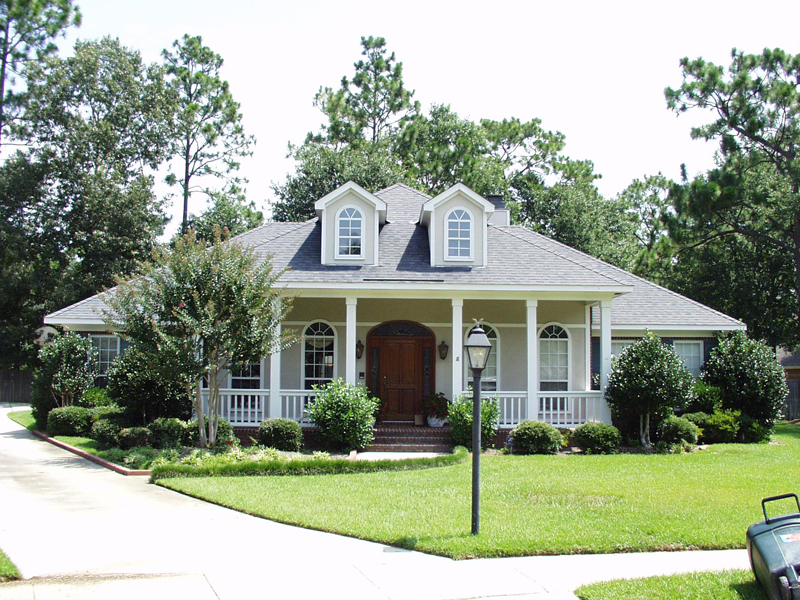 Home With Covered Porch Has Stylish Southern Charm