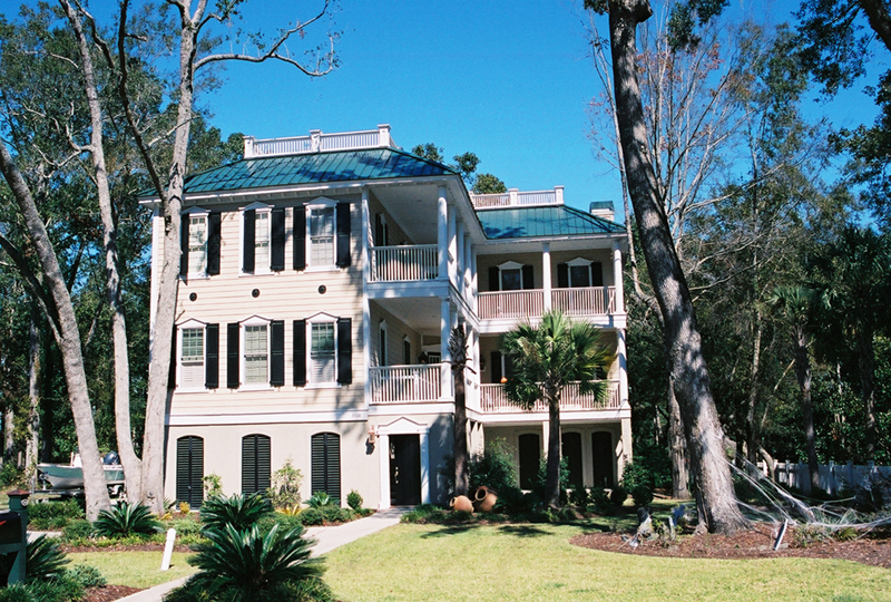 Raised Southern Plantation Home With Multiple Level Wrap-Around Porches