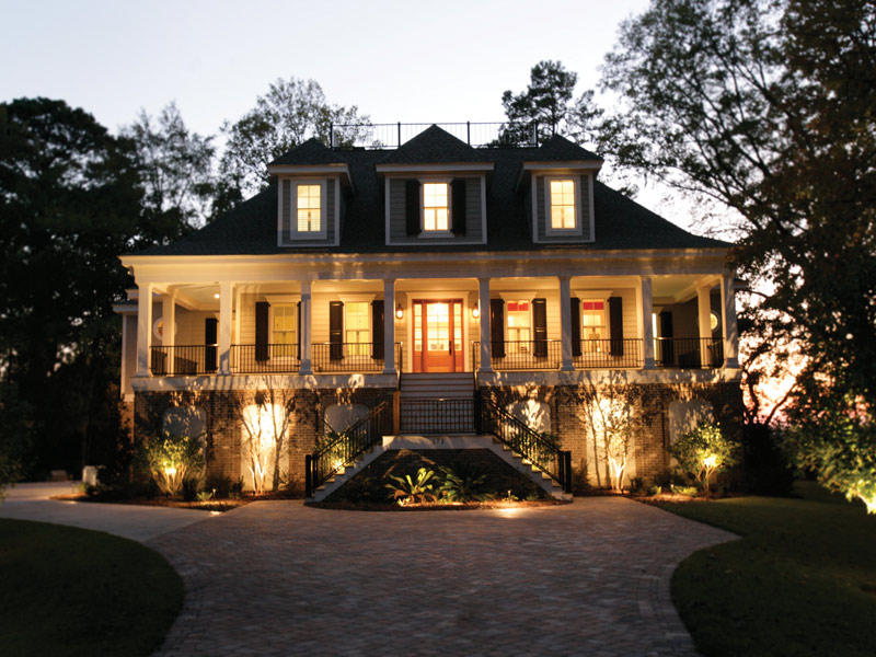 Luxury House Plan Front Night Photo 01 024S-0021