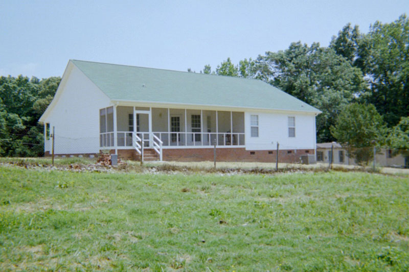 Acadian House Plan Rear Photo 01 - 028D-0036 | House Plans and More