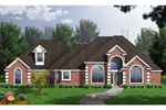 Multiple Gables And Arched Windows Decorate This Brick Ranch