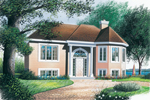 Arched Entry And Columns Grace This Stunning Design