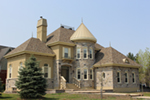 A Distinctive Turret Is The Focal Point Of This European Home