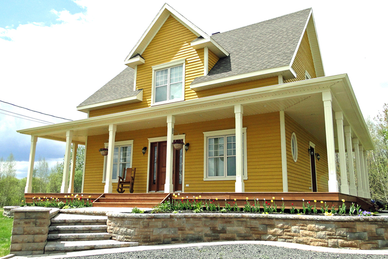 Covered Porch Surrounds This Country Home
