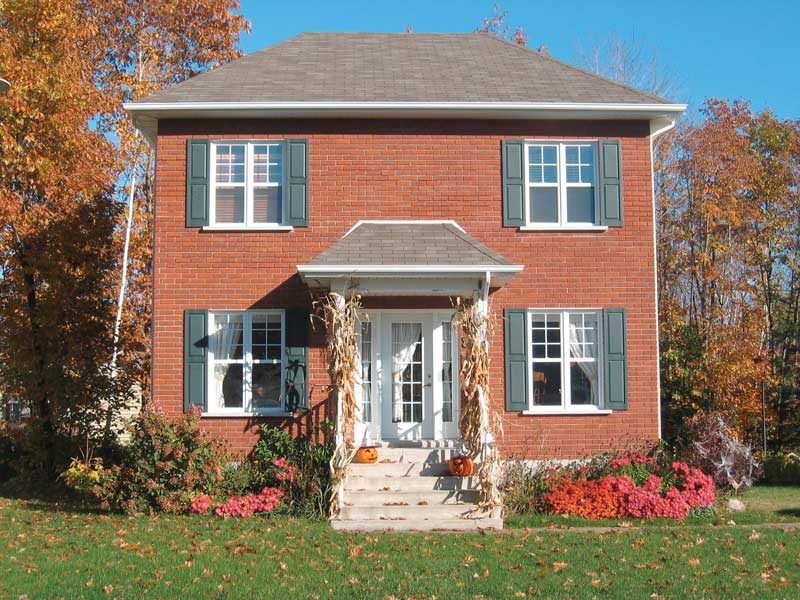 A Decorative Dormer Tops This Colonial Inspired Home