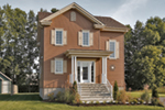 Narrow Lot House Has Colonial Attributes With Columned Porch