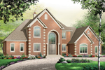 Luxurious Traditional Two-Story Has Tall Arched Front Entry