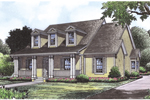 Triple Dormers Lift This Home With Friendly Acadian Style