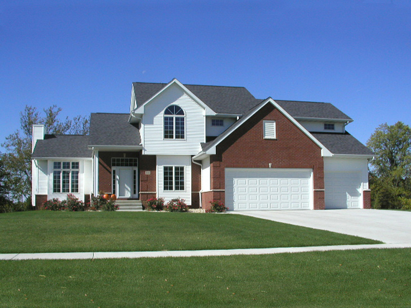 Traditional Two-Story House With Brick And Siding Combination