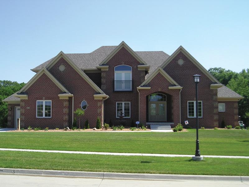 Brick And Shingle Siding Give This Home A Craftsman Presence