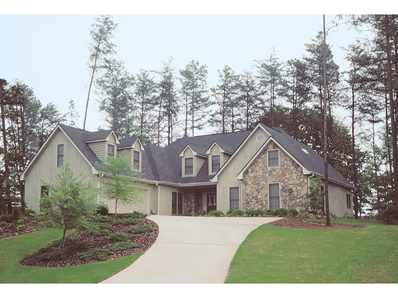 Country Style Home With Stone Accents And A Side Entry Garage
