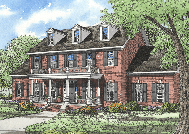 Traditional Two-Story Brick House With Pillared Porch And Balcony Above