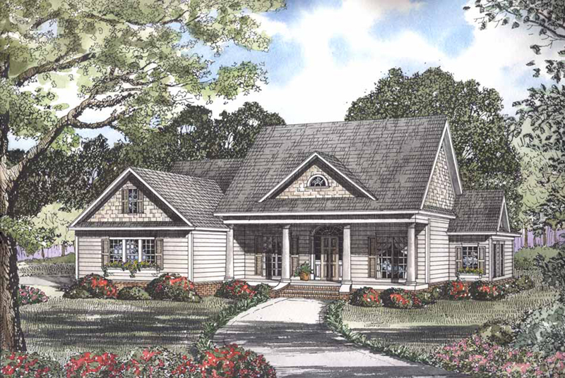 Shingle Sided Dormers Add Interest To This Two-Story House