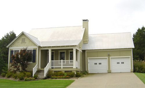 Country Style Home Has Shingle Sided Gable And Covered Front Porch
