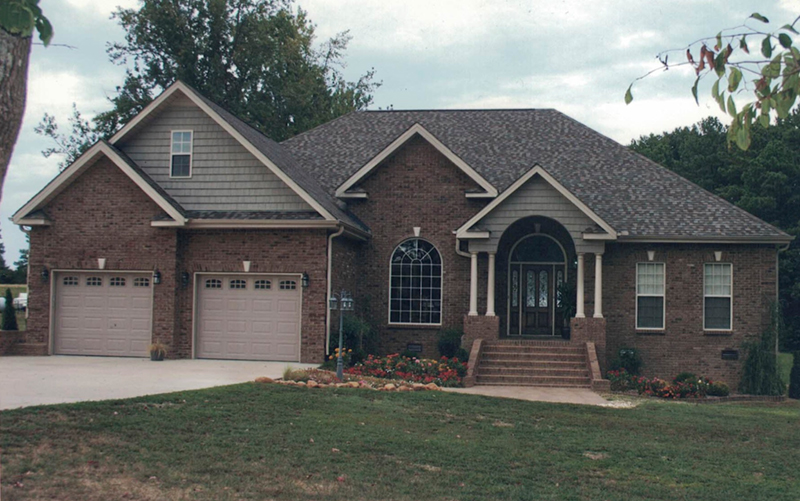 Traditional Brick Ranch Home Has Corner Quoins And Arched Front Entry