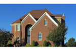 Home With Dramatic Arched Brick Entry