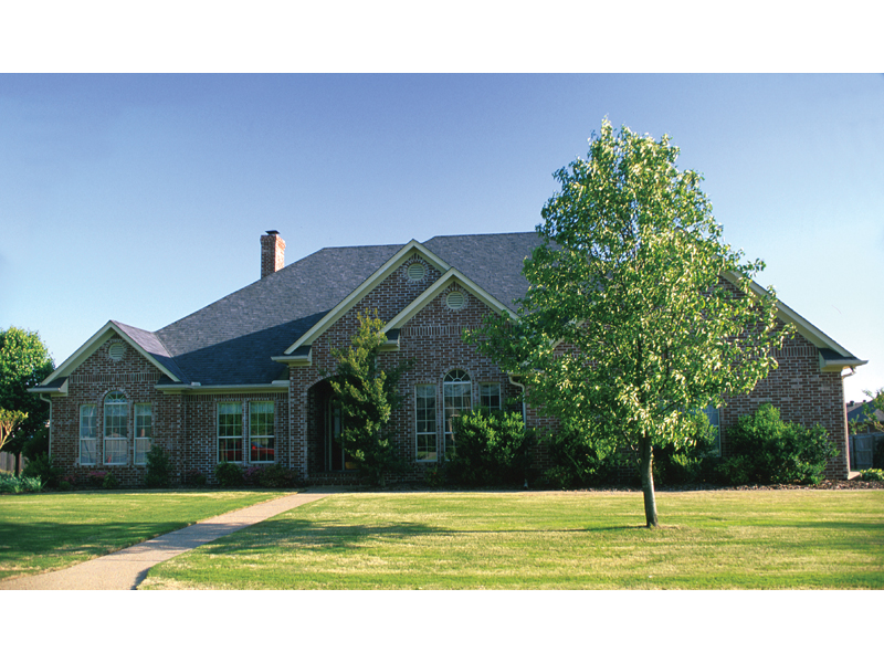 Luxurious All Brick Ranch With Multiple Gables And Arched Windows