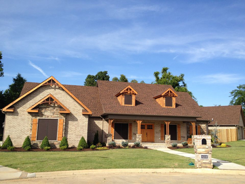 Porch And Dormers Decorate Exterior Of This Home