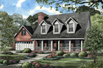 New England Style Home Has Triple Dormers On Roof