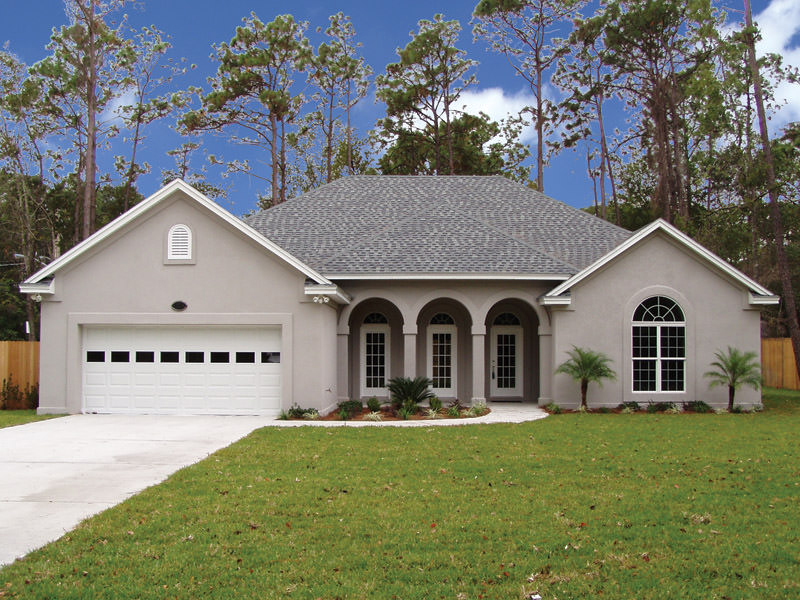 Triple Arches Flank The Porch Of This Sunbelt Home