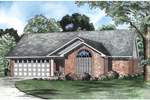 Pleasing Arched Window Adds Style To This Brick Ranch