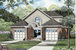 Symmetrical Traditional Home With Alluring Arched Entryway