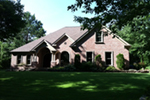 Brick Ranch House With Raised Entry And Great Curb Appeal