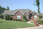All Brick Traditional Home With Dramatic Arches